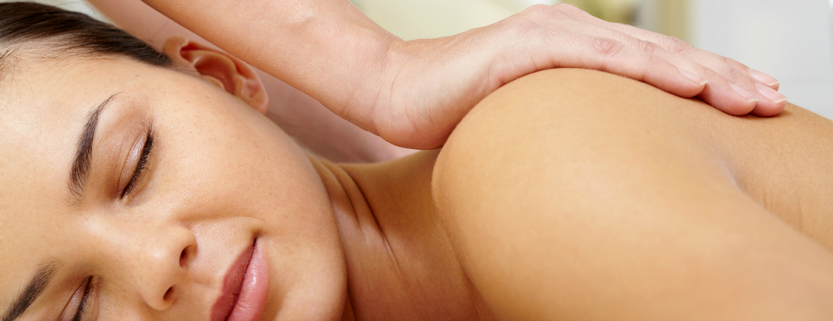 Portrait of young and calm female enjoying body massage